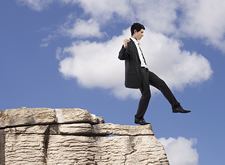 Businessman Stepping Off Rock